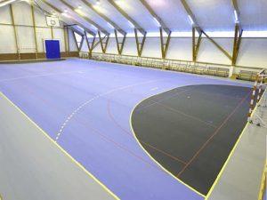 Pintura de pavimentos industriales y canchas deportivas. NORDCOLOR.